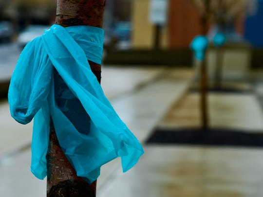 Teal ribbons tied to the trees along the sidewalks in downtown Marion signify that April is Sexual Assault Awareness Month.