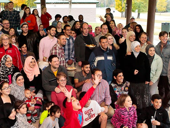 Muslims and Christians gather for a group photo during