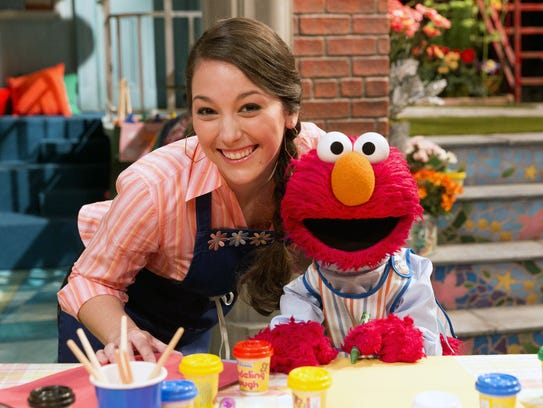 "Suki Lopez, as Nina, left, and Elmo appear on ""Sesame"