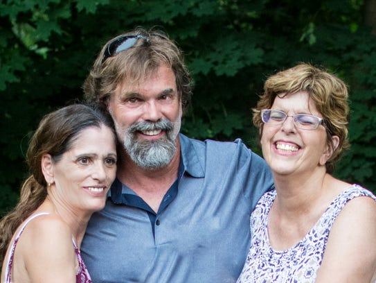 Triplets Brenda Pagano, left to right, Brad Forrest