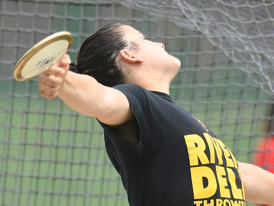 River Dell's Laura Rizik competes in the discus at