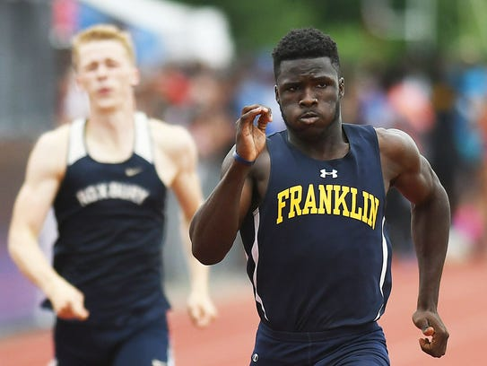 Franklin's Mario Heslop wins the 400 at the Meet of Champions.