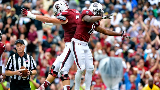 USC wide receiver Pharoh Cooper (11) celebrates with offensive lineman Mason Zandi (74) after scoring a touchdown early in the third quarter against UCF at Williams-Brice Stadium on Saturday, September 26, 2015.