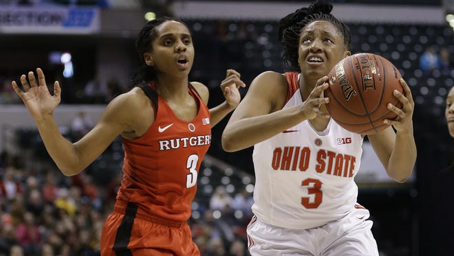 Ohio State Buckeyes guard Kelsey Mitchell (3) drives around Rutgers Scarlet Knights guard Tyler Scaife (3) in the first half of their Big Ten Women's Basketball Tournament game Friday, Mar 4, 2016, at Bankers Life Fieldhouse in Indianapolis.