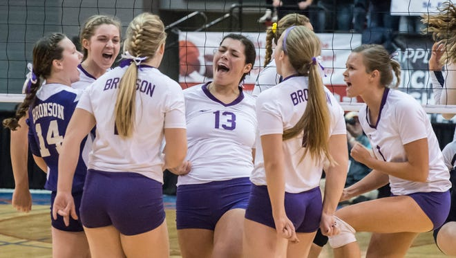 Bronson players celebrate after a point during the 2015 semifinals against TC St. Francis.