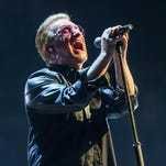 In this May 26, 2015 file photo, Bono of U2 performs at the Innocence + Experience Tour at The Forum in Inglewood, Calif.
