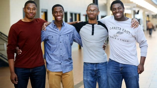 Lakota East seniors and quadruplet brothers from left, Zachary, Aaron, Nigel, and Nick Wade pose together at Lakota East High School, in Liberty Township, Ohio, Wednesday, April 5, 2017. All the brothers have been accepted at some of the nation's top universities, including each of them to both Yale and Harvard.