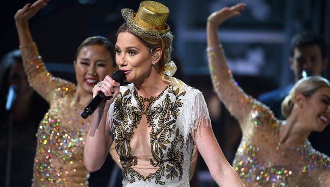 Jennifer Nettles sings and dances during CMA's Country Christmas special taping at the Grand Ole Opry on Sat.  Nov. 7, 2015. Nettles is the host for the show which will air on ABC on Dec. 3.