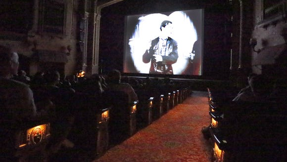 The audience views silent short films Thursday in the