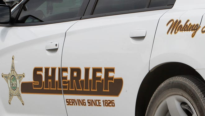 Sheriff deputies and Lafayette firefighters rescued two women Saturday who were stranded in the Wildcat Creek.