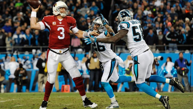 Milton High grad Cortland Finnegan (26) applies pressure on Arizona Cardinals quarterback Carson Palmer during Sunday's NFC Championship Game. Finnegan, a 10-year NFL player, along with Tate grad Graham Gano are headed to the Super Bowl with the Carolina Panthers.