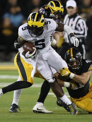 Jabril Peppers is tackled by Iowa defenders during the second half of U-M's 14-13 loss Nov. 12, 2016 in Iowa City.