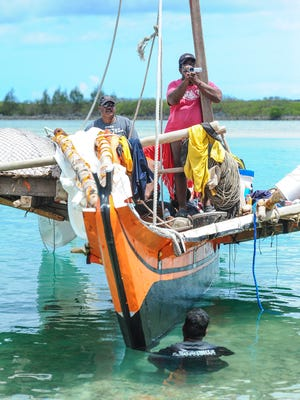 Local residents, visiting islanders and others line the shore of the Paseo de Susana in Hagãtña to greet seafarers arriving on three traditional sailing canoes from Chuuk on Monday, May 16. The canoes — one from the island of Houk and the others from Polowat — sailed to Guam for the 2016 Festival of the Pacific Arts, said Cy Esu, a cousin of the navigators.