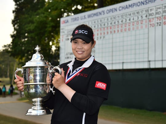 Jun 3, 2018; Shoal Creek, AL, USA; Ariya Jutanugarn poses with the championship trophy after defeating Hyo-Joo Kim (not pictured) in a sudden death playoff in the U.S. Women's Open Championship golf tournament at Shoal Creek. Mandatory Credit: Jasen Vinlove-USA TODAY Sports
