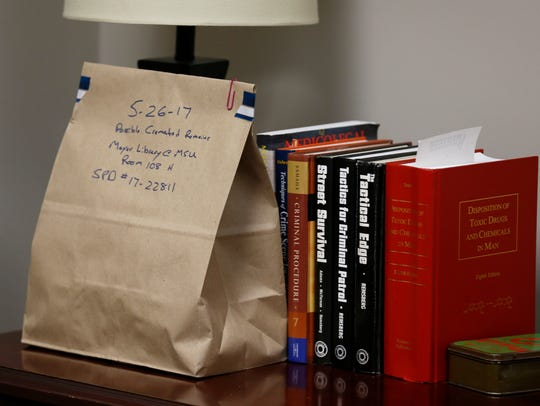 A bag of possible cremated remains in the office of