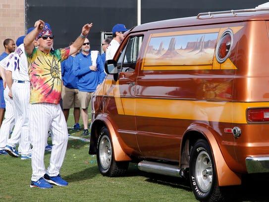 Cubs manager Joe Maddon arrives in  1976 Dodge van.