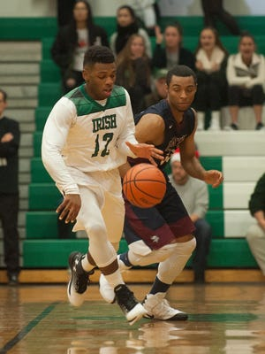 Camden Catholic senior guard Nazir Streater heads down court after a steal during the first half of Friday's season opener against Eastern.