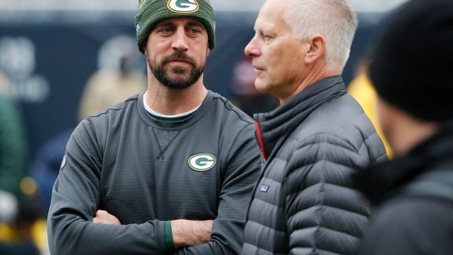Green Bay Packers quarterback Aaron Rodgers talks to ESPN's Kenny Mayne before a game against the Chicago Bears on Nov. 12, 2017, in Chicago.