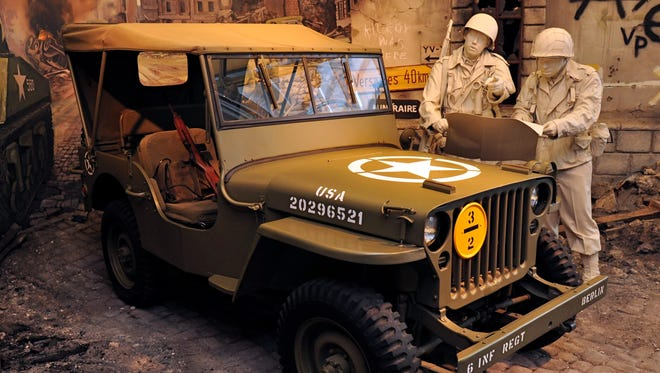 """1943 Willys-Overland Jeep.  In 1939, with war raging in Europe, the U.S. Government issued a requisition for a light military reconnaissance vehicle for the Army.  Willys-Overland won the contract with its """"MA"""" (and later MB) design of 1941.  But the Army, and the world, came to know this rugged little 4 X 4 as the Jeep and Willys-Overland went on to build more than 368,000 vehicles during World War II.  Willys trademarked the name after the war and turned the Jeep into a workhorse civilian utility vehicle.Picture received Sept. 2011 from the Walter P. Chrysler Museum's Adopt  a Vehicle program enables individuals and groups to support the care and maintenance of a favorite vehicle on exhibit in the Museum.  There are 32 total vehicles within the Museum's permanent collection that are """"adoptable,"""" with 17 currently available for adoption.  the pictures are the ones up for adoption."""