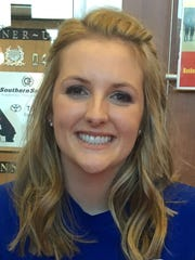 Megan Sawyer signs to play water polo at San Jose State on Wednesday during National Signing Day.