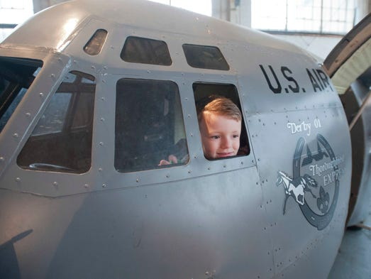 Lachlan Laird, 5, peeks through the window of a miniature C-130 (sponsored by the Kentucky Air National Guard) at the McDonalds Thunder Preview Party at Central American Airways Flying Service hangar in Bowman Field. 03 April 2013