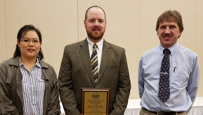 Andrew McLean (center) is joined by UW-River Falls faculty Youngmi Kim (left) assistant professor of agricultural engineering and Joe Shakal, chair and associate professor of agricultural engineering.at the ASABE meeting in Oshkosh.