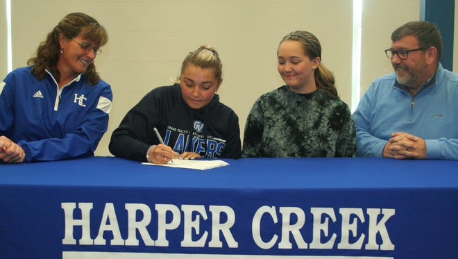 Harper Creek diver Devon Larson has signed a National Letter of Intent to attend Grand Valley State University. She is joined by, from left, Harper Creek coach Corrin  Buck, Ava Larson and Mike Larson.