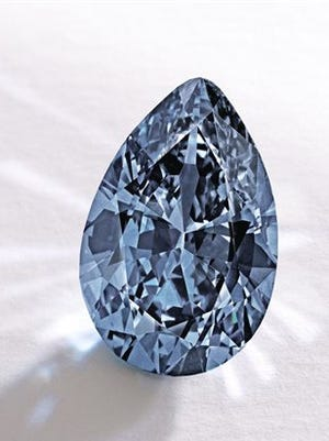 """In this image provided by Sotheby's shows a Fancy Vivid Blue pear-shaped diamond from the estate of Rachel """"Bunny"""" Mellon which sold Thursday for $32.6 million. It's an auction record for any blue diamond. It was sold to an anonymous Hong Kong collector."""