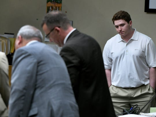 William Riley Gaul watches as his attorney talks with