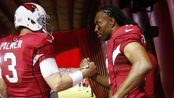 Quarterback Carson Palmer (3) and wide receiver Larry
