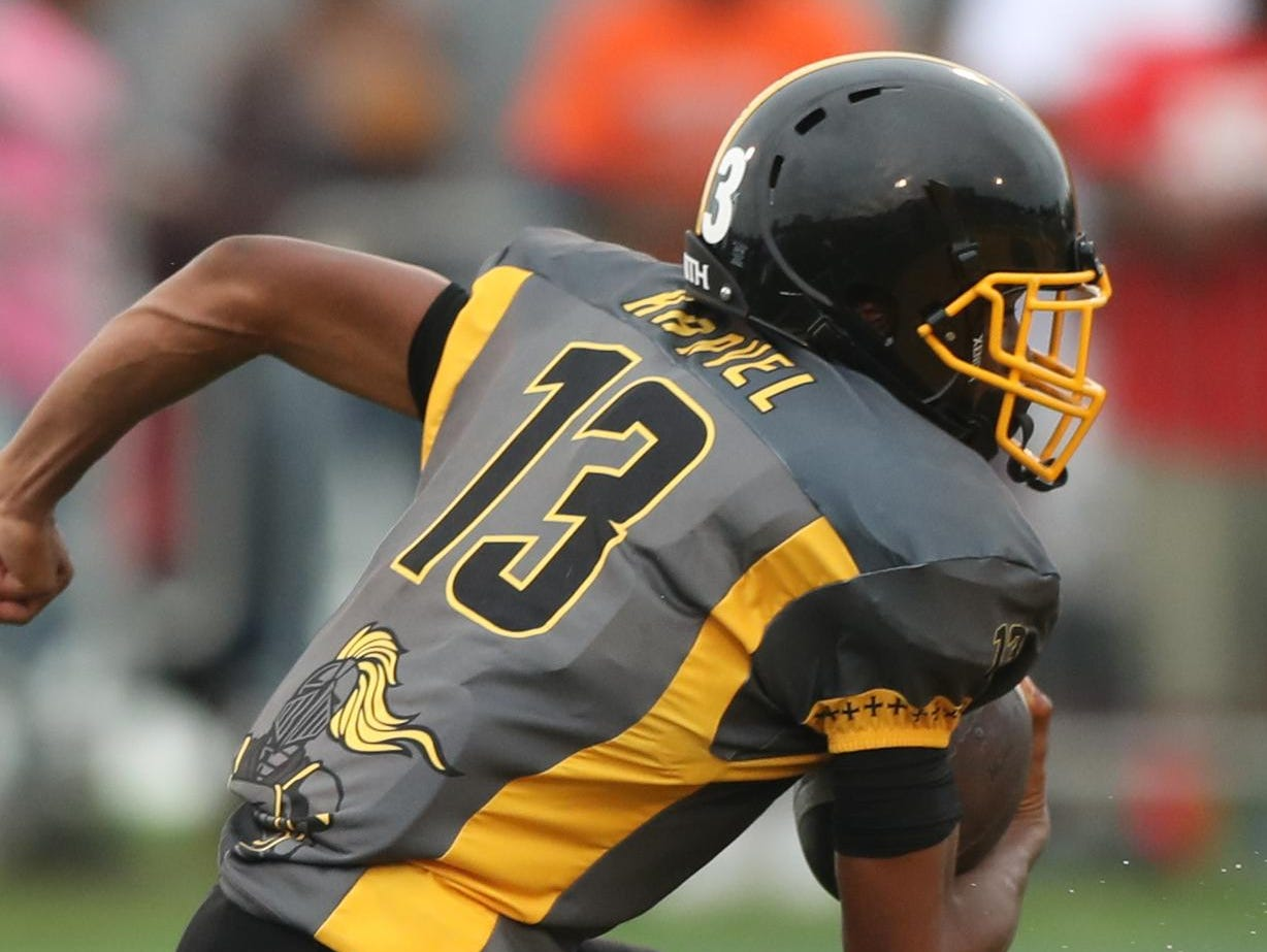 """With """"Harvel"""" on the back of his jersey, King's Ambry Thomas runs for a TD."""