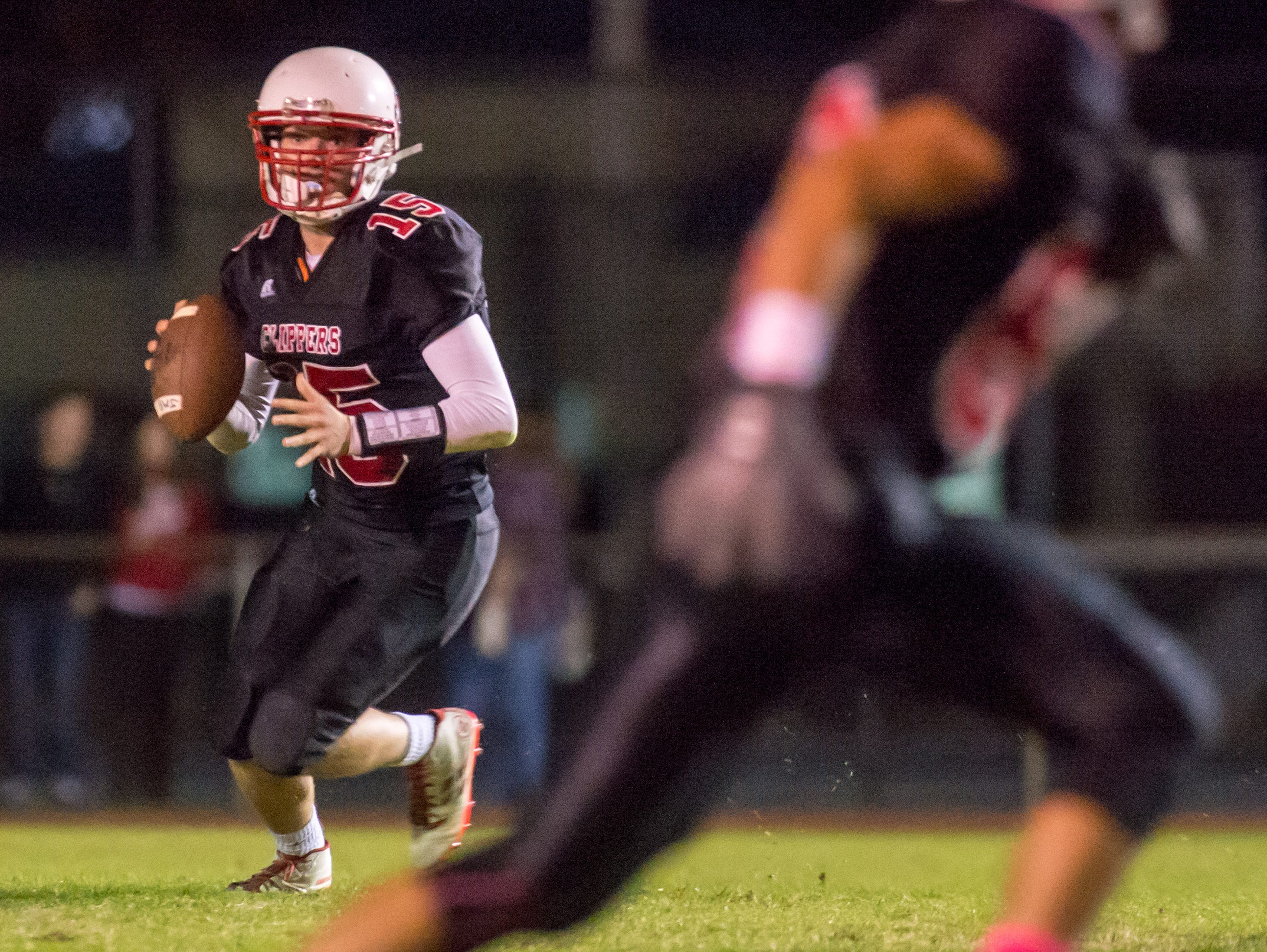 James M Bennett quarterback Joey Geary (15) rolls out for a pass against North Caroline on Friday night at Wicomico County Stadium.