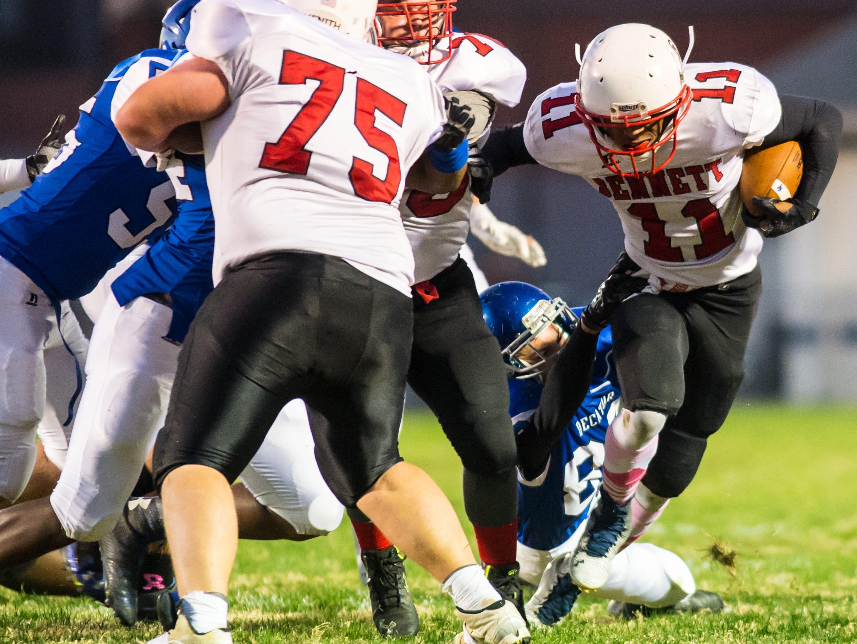 James M Bennett running back Ty King (11) rushes against Stephen Decatur on Friday night at Seahawk Stadium in Berlin.