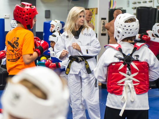 Grandmaster Kim Heany leads sparring during Tae Kwon Do class at Chesapeake Martial Arts on Thursday evening.