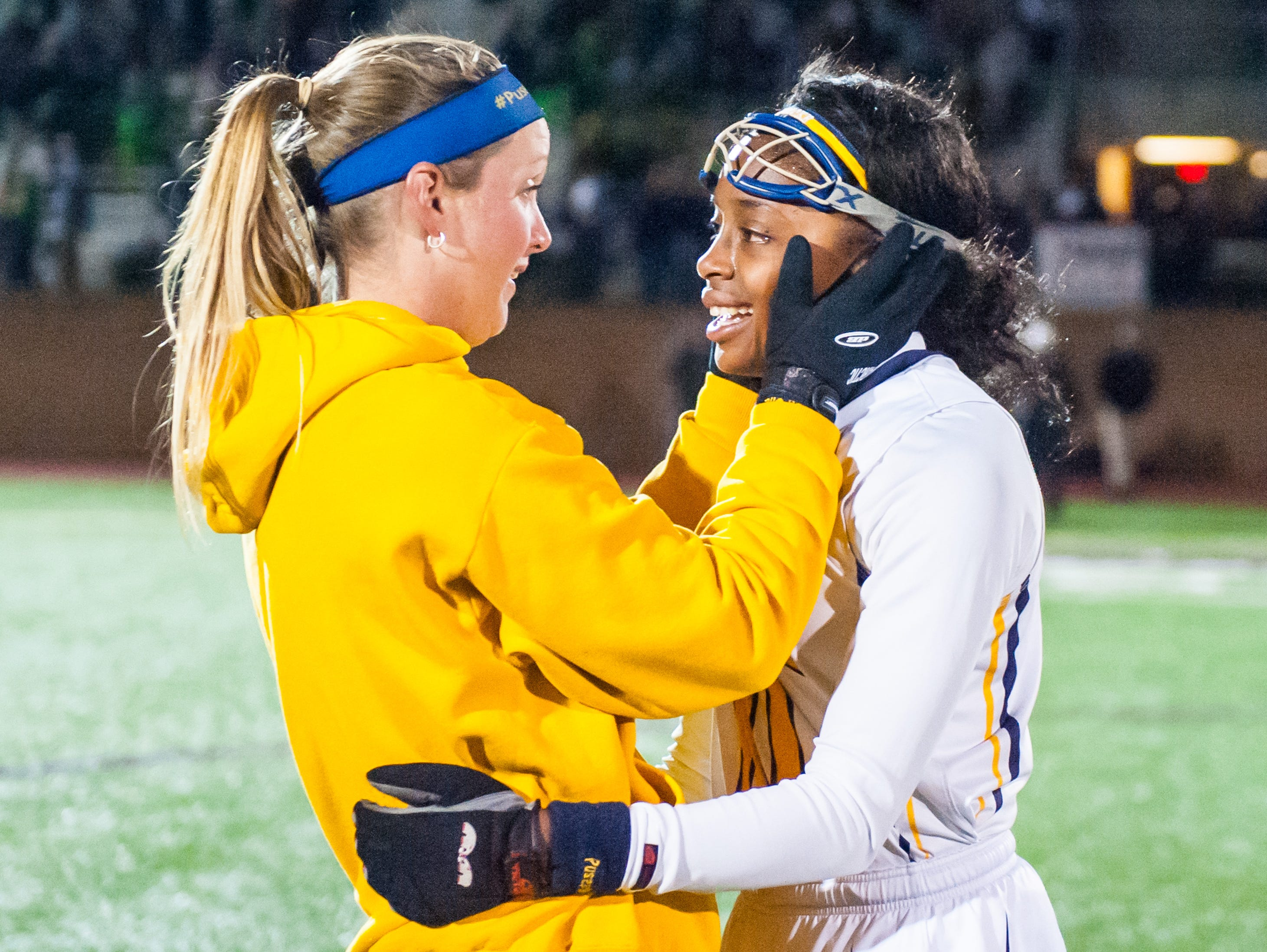 Pocomoke midfielder Shayla Jones (10) and head coach Brandi Castaneda embrace after winning the MPSSSAA 1A State Finals on Saturday evening at Washington College in Chestertown