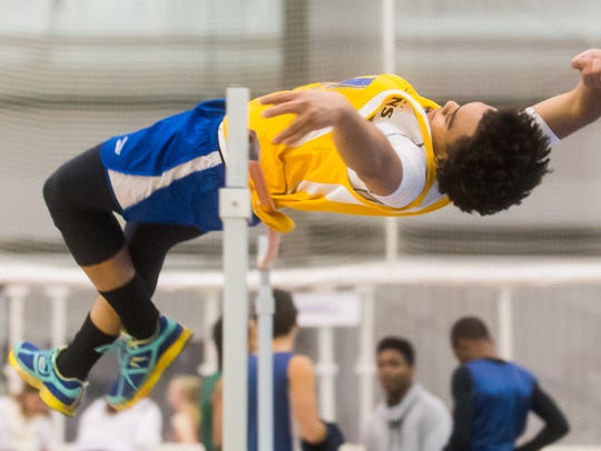 A Wicomico High jumper attempts to clear the high bar