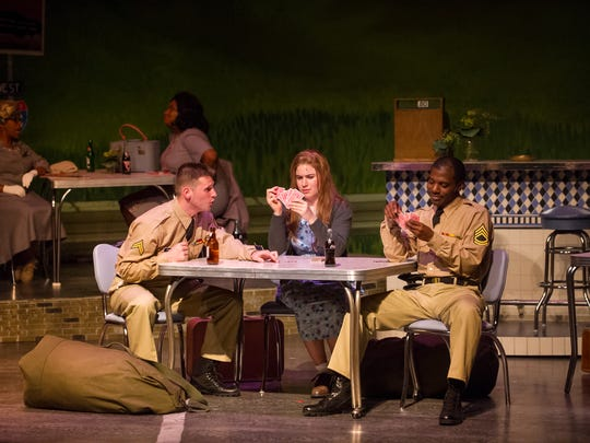 "Alex Mace, Allie Babich and Lamar Jefferson bond during a bus ride through the south in Skylight Music Theatre's ""Violet."""