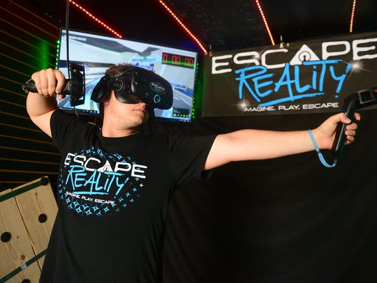 Alex Feree, demonstrates one of the virtual reality