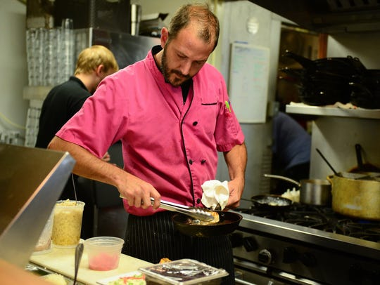 14 Global Head Chef Kevin Daughaday prepares the Pan