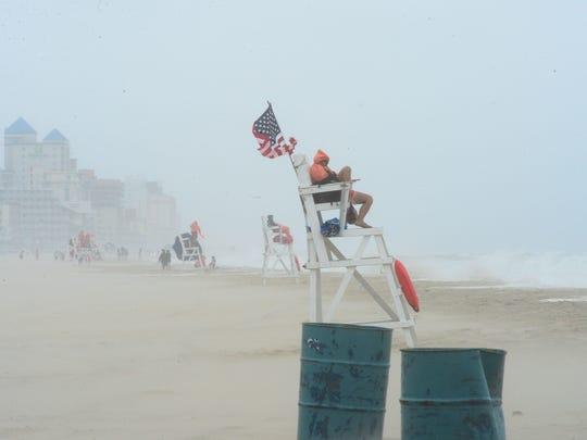 A Ocean City Beach Patrol Lifeguard endures the high
