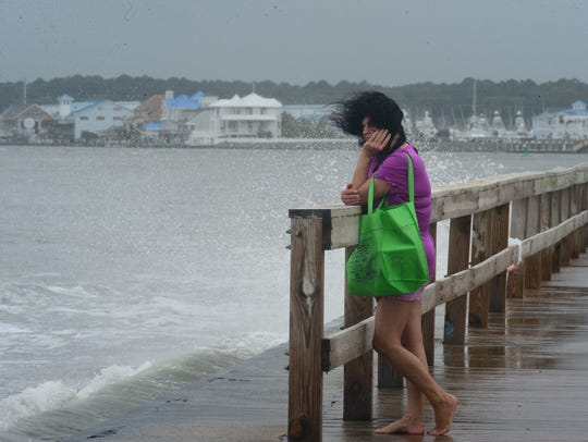 A woman's hair blows in the high winds in Ocean City,