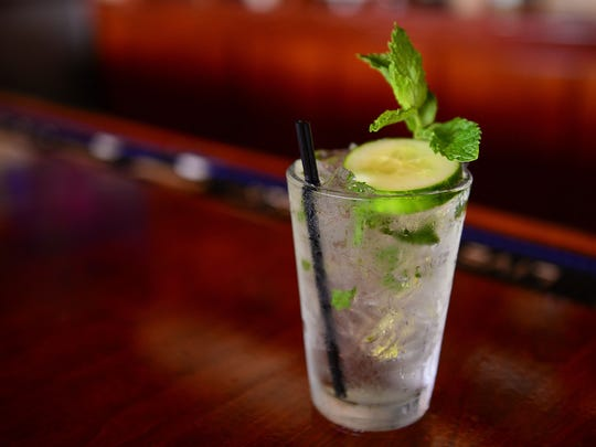 One featured Summer cocktail includes the Cucumber Cooler with vodka, st. germaine, lemon juice, simple syrup, mint leaves and sierra mist. Tuesday, July 25, 2017.