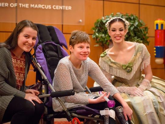 Best Buddies Ava Lemke (left) and Tatyana Spidell visit