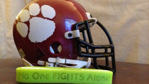 Asheville High football coaches and players wore these wristbands in Charlie Metcalf's honor during the 2013 season.