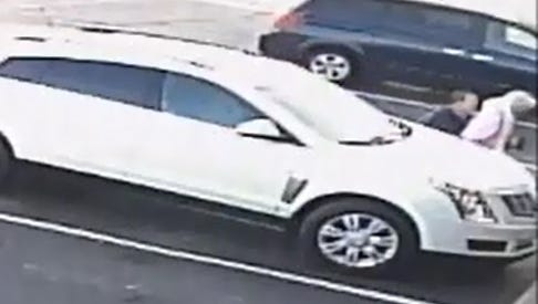 Video surveillance shows an 81-year-old woman being robbed in a parking lot on Madison Street in Clarksville on Dec. 16.