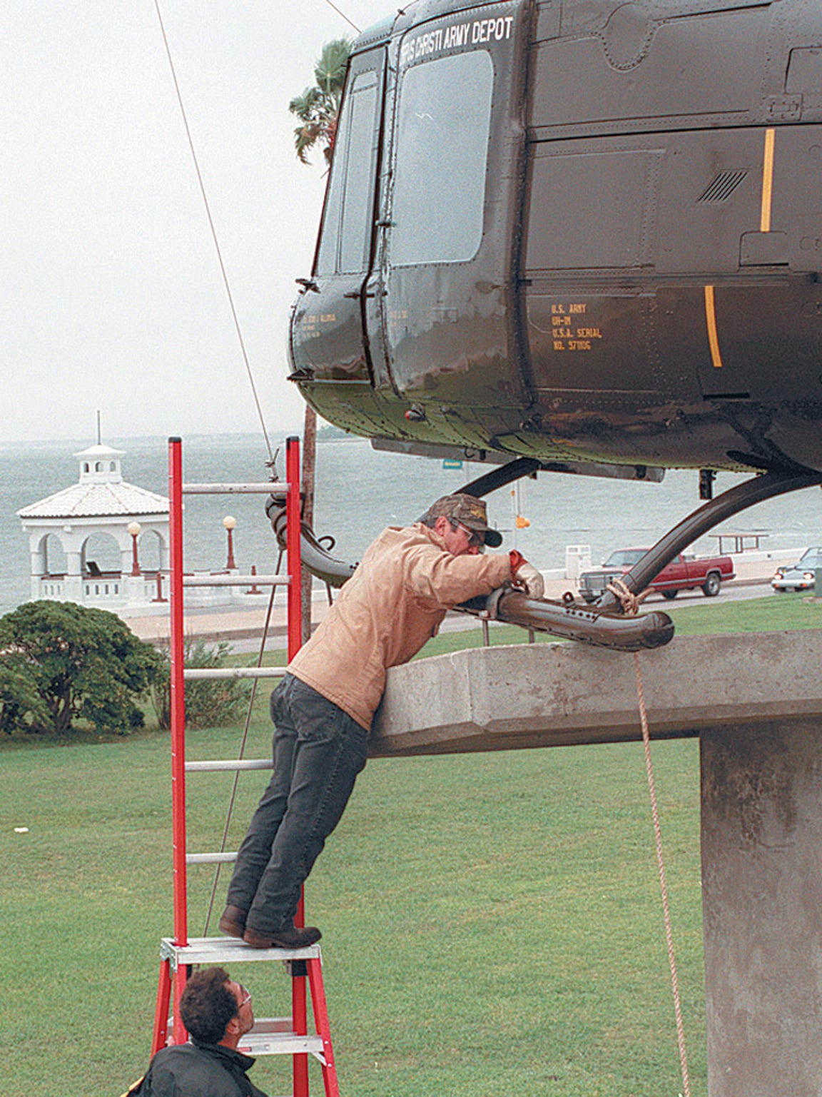 A UH-1H helicopter is installed on the memorial pedestal