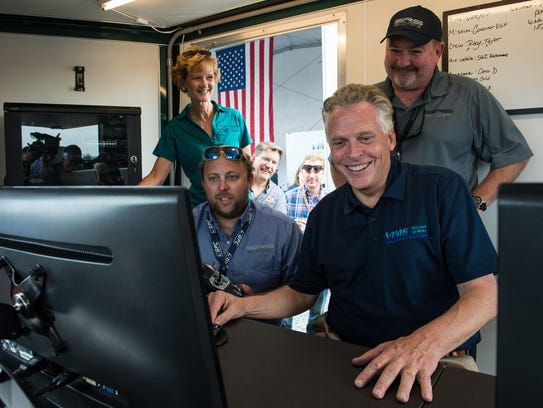 Virginia Governor Terry McAuliffe operates a drone
