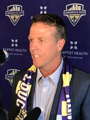 Louisville City FC coach John Hackworth speaks with