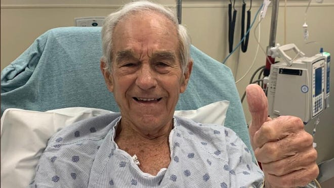 """Ron Paul, the former Texas congressman and presidential candidate, was admitted to a Texas hospital after suffering an apparent medical emergency during a YouTube livestream. Paul tweeted a photo from his hospital bed Friday afternoon, saying he is """"doing fine."""""""
