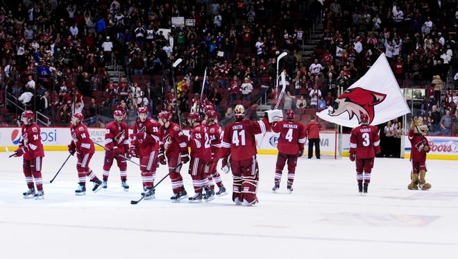 The Phoenix Coyotes salute fans after beating the New Jersey Devils 3-2 at Jobing.com Arena in January.